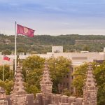 campus photo with mcmaster flag