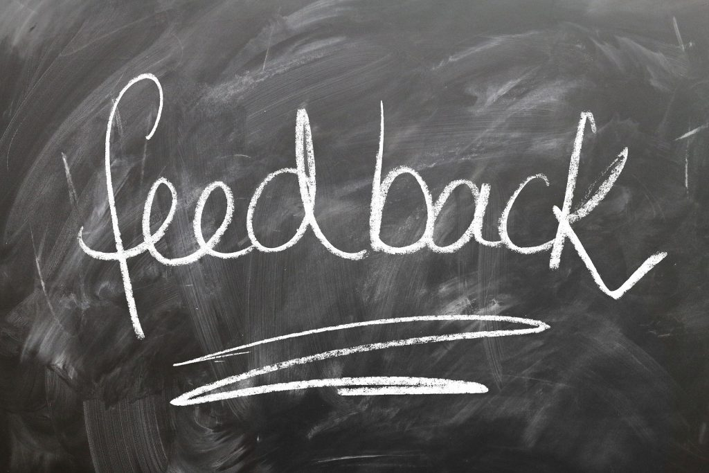 the word feedback written on a chalkboard