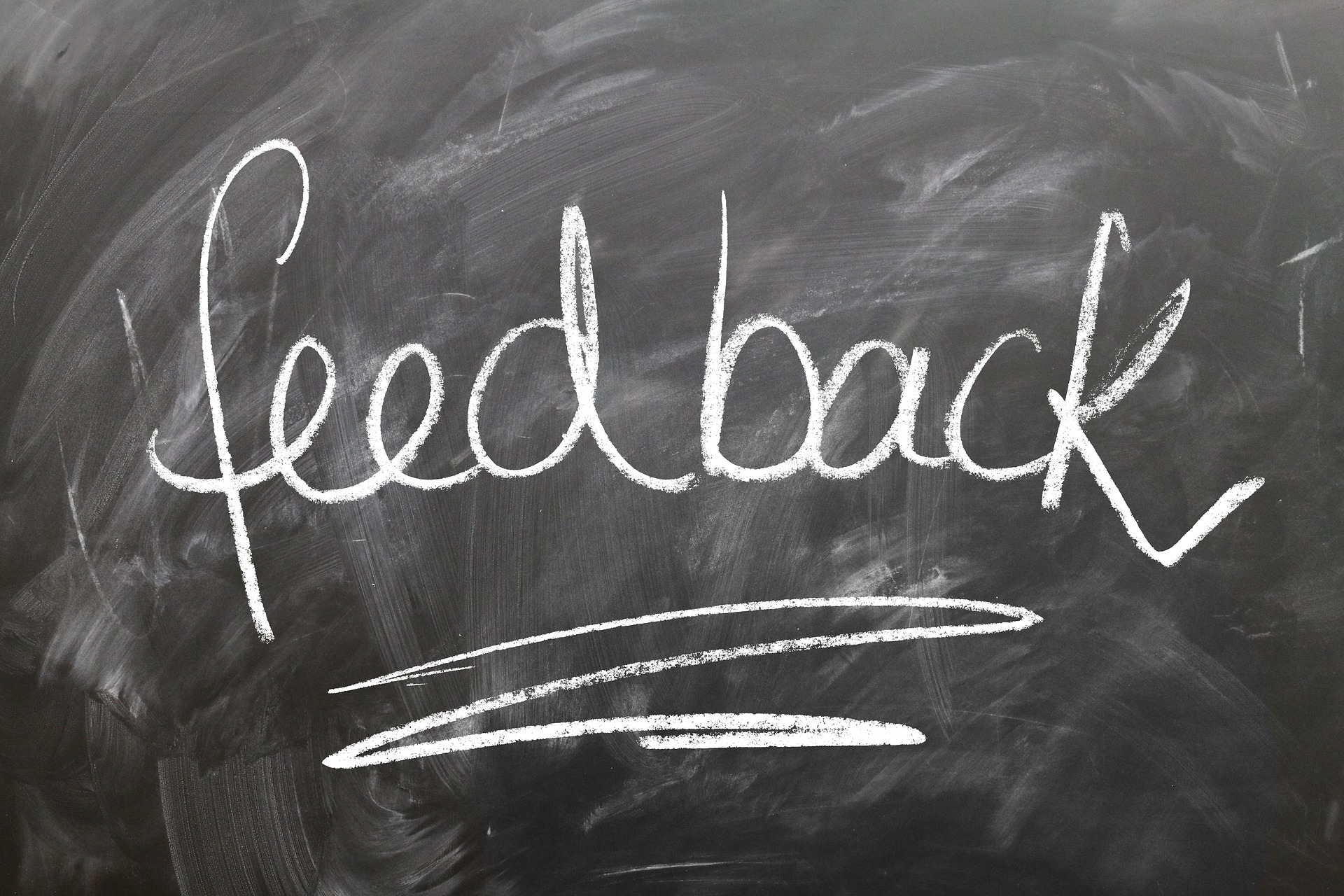 the word feedback written on a chalkboard