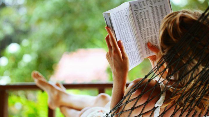 person in hammock reading