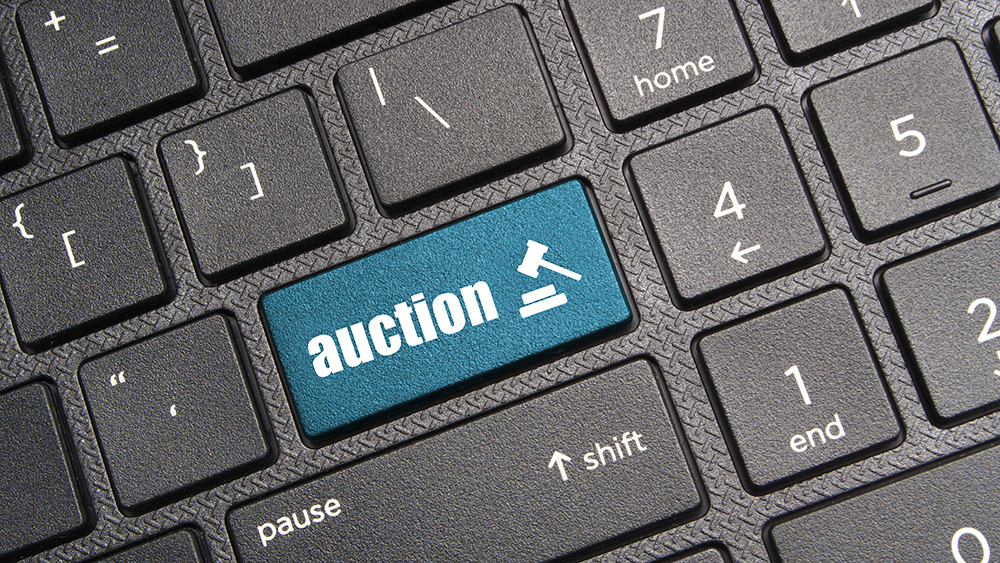 computer keyboard with auction button