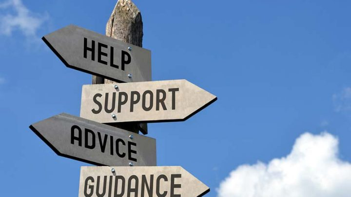 directional sign that reads help support advice guidance