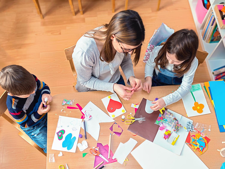 kids making crafts at table