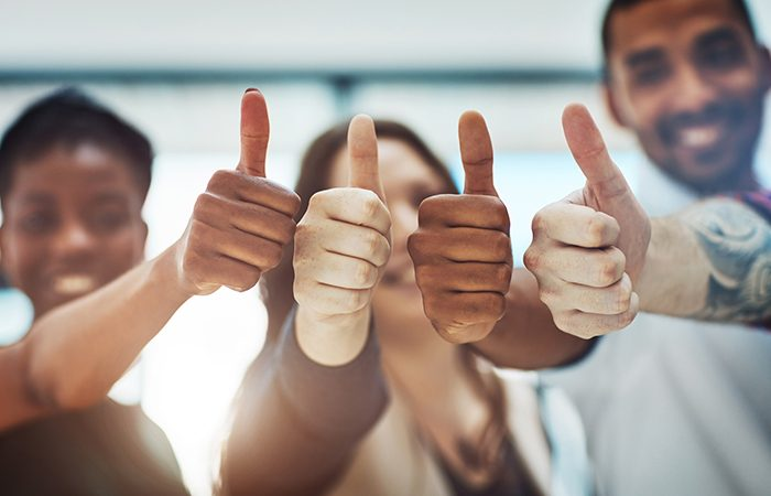 group giving thumbs up