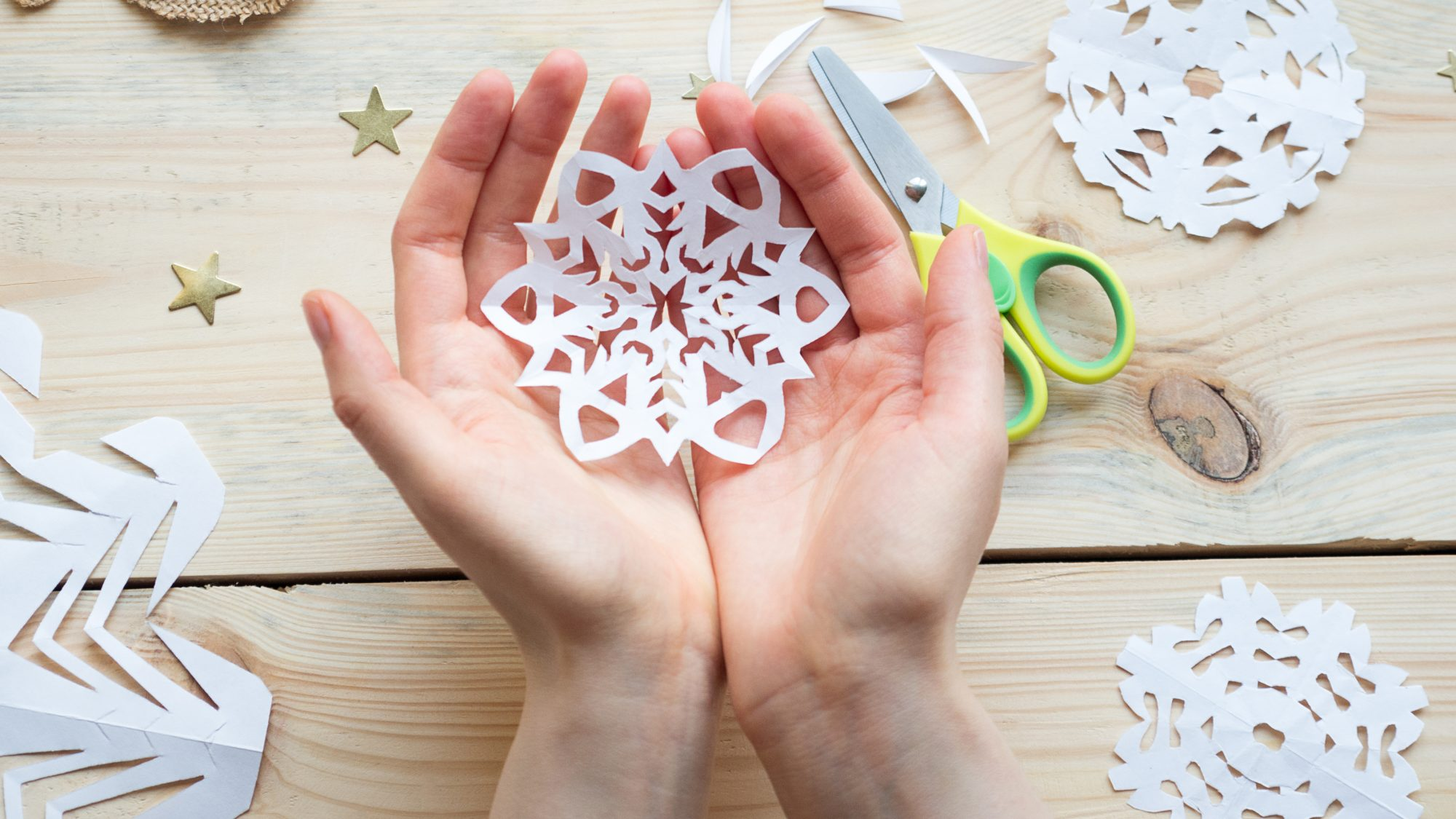 paper snowflake in hands